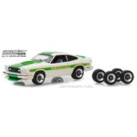 Greenlight 1:64 Scale 1978 Ford Mustang II Cobra II with Spare Tires (White with Green Billboard Stripes)